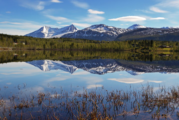 Wall Mural - Lake in Norway with snowcapped mountain
