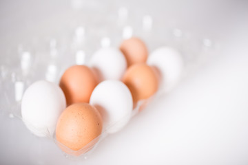 Brown organic eggs and white eggs
