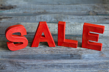 Sale red letters on vintage wooden boards