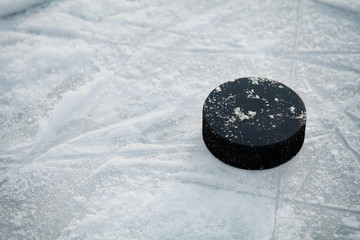 Hockey puck on ice hockey rink