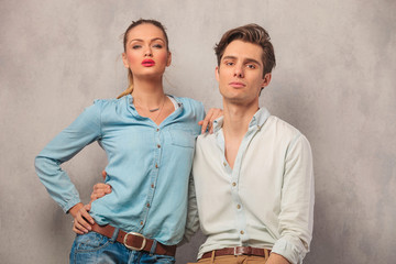 portrait of young couple holding each other in studio