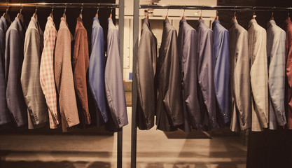 Men suits in a fashion store.