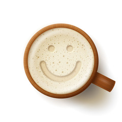 Wooden mug with frothy drink and smiling face