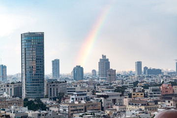 modern cityscape view with rainbow