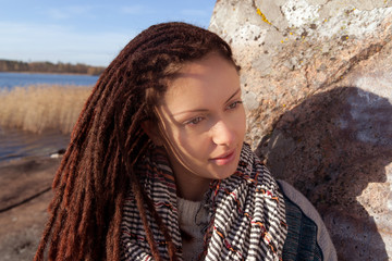 portrait of a girl with dreadlocks at nature