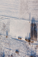 aerial view  over the harvest fields in winter