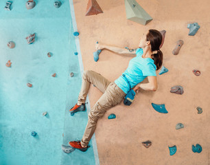 Climber woman training indoor