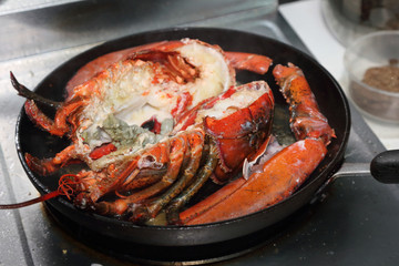 cooked lobsters in a pan