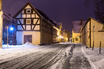 Narrow snowy street with half-timbered residential houses. Market street. Old town of Klaipeda city, Lithuania