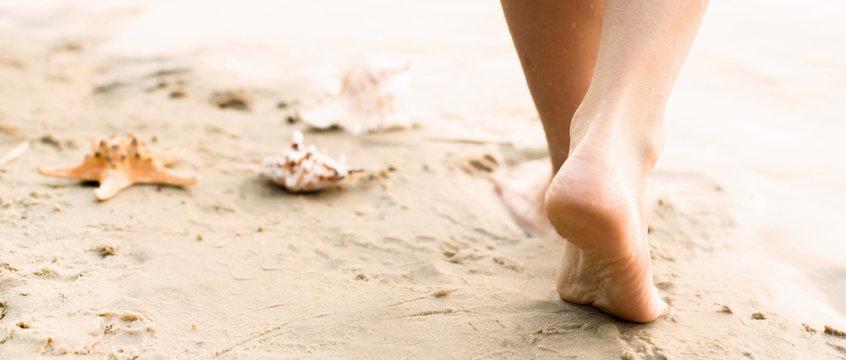 Beach travel - woman walking