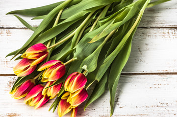 Tulips on wooden background useful as greetings card with copy-space