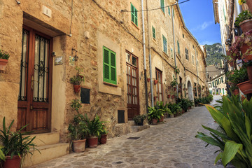 Cobbled street with her pots and plants decorating the houses entraces, Valldemossa, Mallorca, Spain.