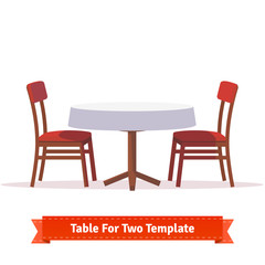 Dinner table for two with white cloth and chairs