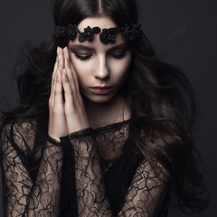 Studio portrait of a beautiful girl in Gothic style