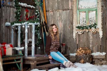 girl with Christmas around porch