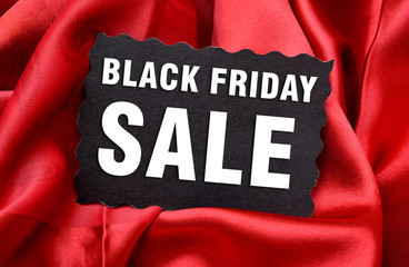 Black Friday Sale Tag with red Silk Background