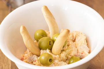 Russian salad in ceramic bowl.