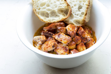 bowl with chickpeas and octopus