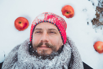 Close up portrait of a bearded man near the apple tree in the winter.