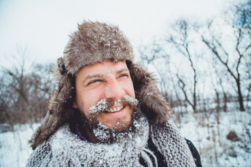 Portrait of a young handsome man with a beard. 