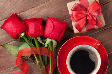 Red roses, Valentines day gift box and coffee
