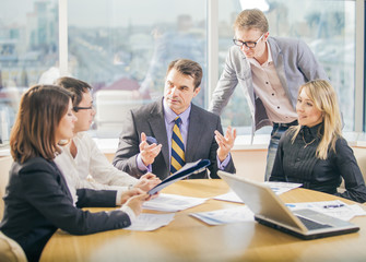 Business people working together in meeting room
