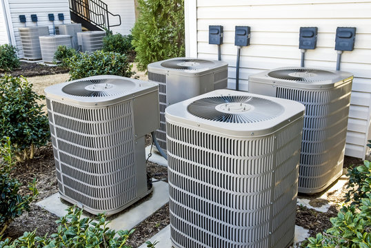 Group of Air Conditioning Units At Apartment Complex