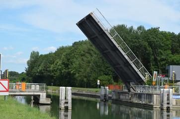 Open bridge over canal and asphalt road
