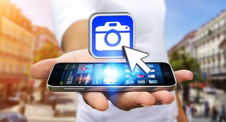 Young man using modern camera application