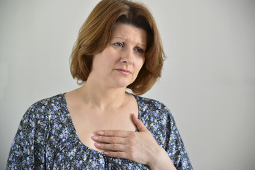 Woman with pain in  chest, angina