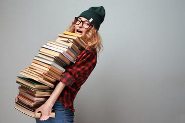 stylish nerd girl with many books