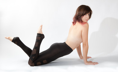 Topless Woman in Shiny Leggings