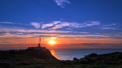 Lighthouse at Cabo da Roca in Portugal at sunset.