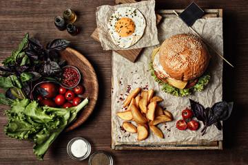 Veggie burger with salad, tomato