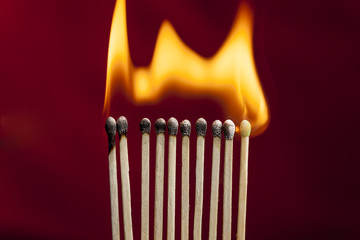 Matchsticks on fire.