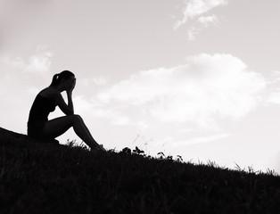 Sad and depressed woman sitting alone