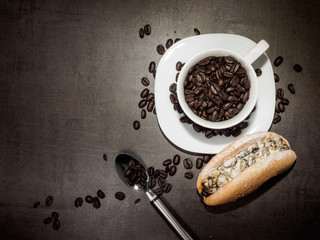 Roasted coffee with french bread on vintage background