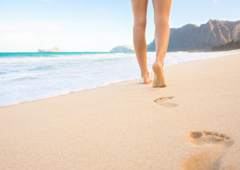 Woman walking on the beautiful beach in Hawaii.