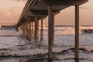 Below Ocean Beach fishing pier in San Diego, California.