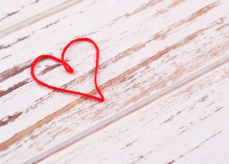 Valentine's Day background. Two paper hearts on wooden backgroun