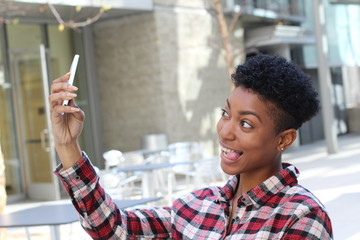 Funny black hip girl make selfie and loll tongue