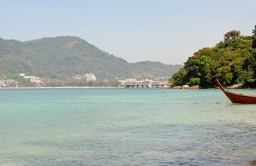 View of the sea, sky and mountains overgrown with jungle Tri Trang Beach in Phuket