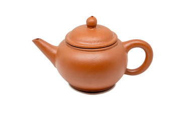 Close up of brown teapot isolated on white