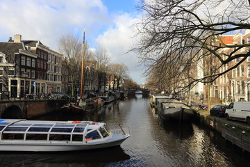 View of Amsterdam canal, typical dutch houses and boats, Holland, Netherlands.