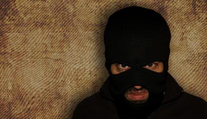 Man in a mask and a black shirt. Balaclava.