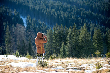 Man taking pictures in mountains