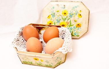 Boiled eggs in a shabby tin box .