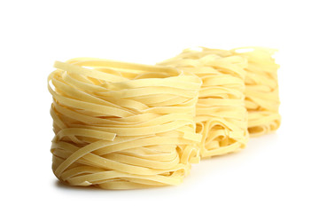 Twisted noodles isolated on white background. Italian food object.