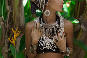 Fashion model posing outdoors with jungle background