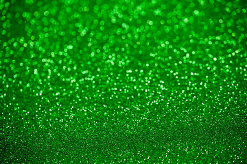 Abstract green bokeh background for Christmas / St Patrick Day holidays